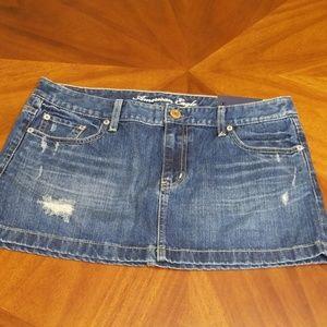 American Eagle denim mini skirt distressed M216